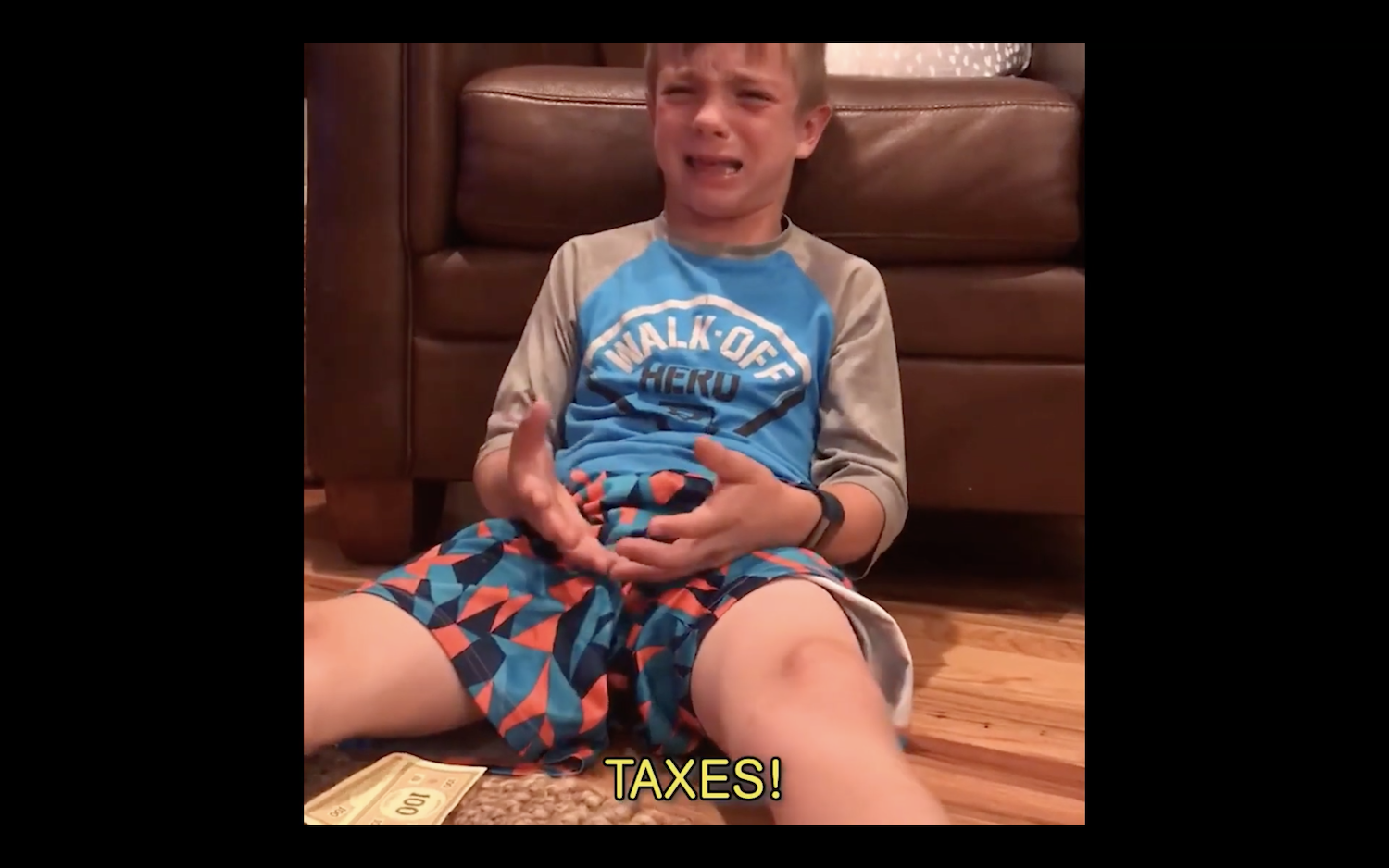 A crying kid because of the taxes in Monopoly game